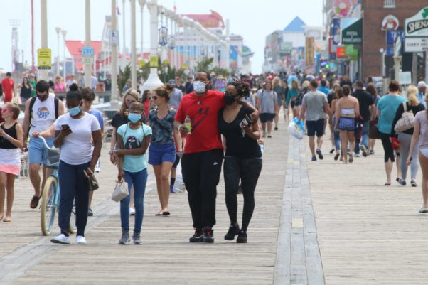 People walk on the Ocean City boardwalk Friday, May 15, many without face coverings. (Photo: Phil Yacuboski/Twitter)
