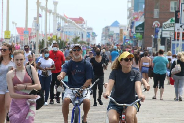 Crowds, many without masks inclduing 2 people on bikes, not wearing masks on a crowded Ocean City boardwalk on May 16. (Photo: Phil Yacuboski/Twitter)