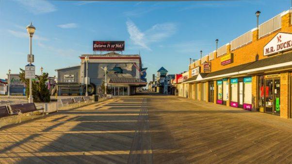 An empty boardwalk in Ocean City, Md., with shops shuttered. (Photo: Ken Krach/Flickr)
