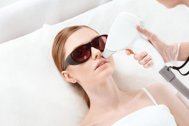 Laser hair removal being performed on a woman's face. (Photo: 123rf)