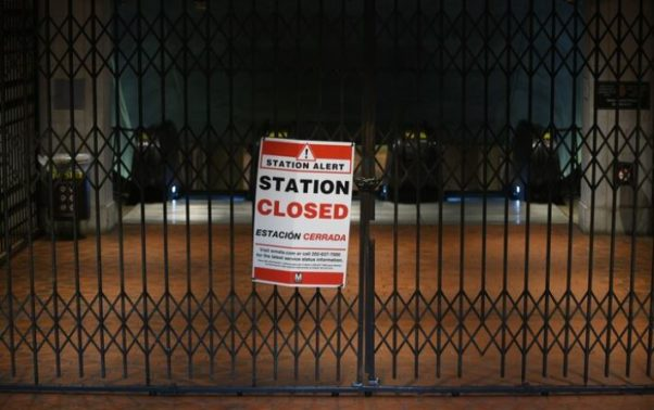 "The enterance to the Federal Triangle Metro station gated and padlocked with a ""Station Closed"" sign on the gate. (Photo: Astrid Riecken)"