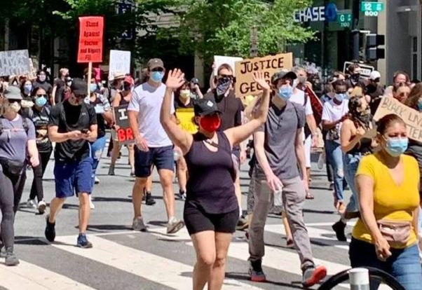 Protesters, some wearing masks and carrying signs, march down a D.C. street on May 31, 2020. (Photo: Cathy Landry/Facebook)