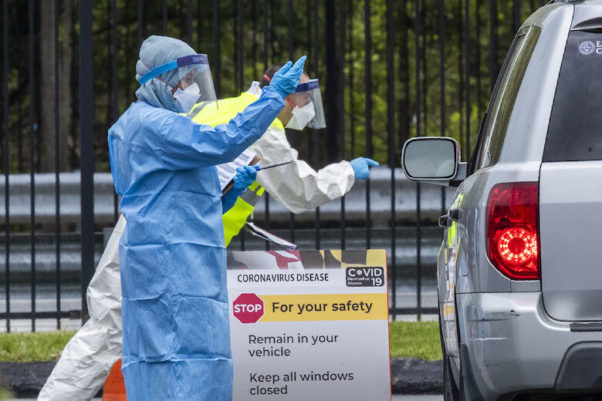 Medical personnel from Montgomery County check patients arriving for a COVID-19 drive-in testing in Silver Spring on April 21, 2020. (Photo: Manuel Balce Ceneta/AP)