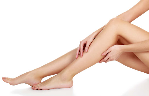 A pair of woman's smooth, bended legs. (Photo: Shutterstock)