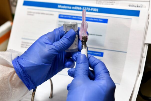 An injection of an experimental coronavirus vaccine developed by the National Institutes of Health and Moderna. (Photo: Hans Pennink/AP)