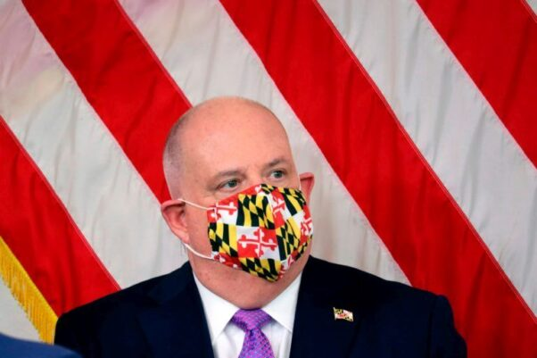 Maryland Gov. Larry Hogan wears a mask with a pattern of the state flag of Maryland during a news conference on Friday, April 24, 2020 in Annapolis, Md. (Photo: Brian Witte/AP)