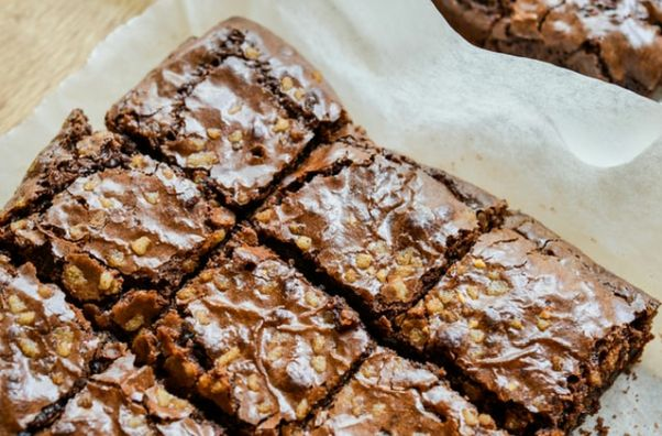 Brownies on parchment paper. (Photo: Michelle Tsang/Unsplash)