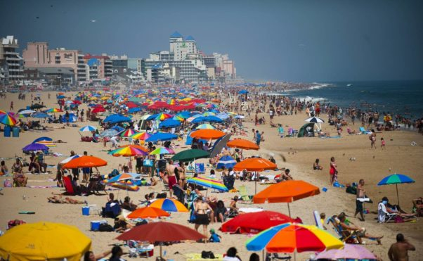 People line the beach in Ocean City, Maryland. (Photo: Jim Watson/AFP/Getty Images)