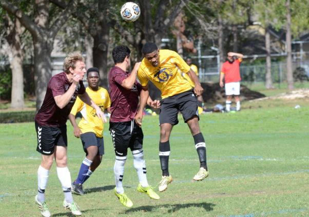 Men playing soccer. (Photo: West Orange Observer)