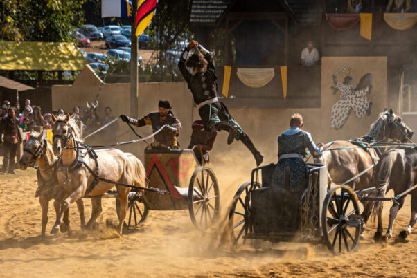 Two men joust on chariots driven by two other men. (Photo: David Gould)