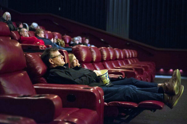 People sitting in a socially distanced movie theater. (Photo: Celluloid Junkie)