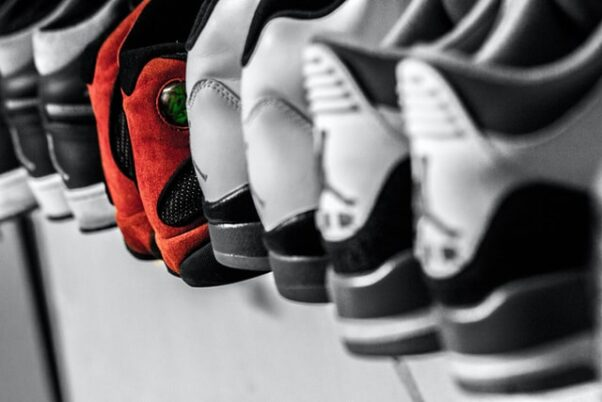 Several pairs of Nikes lined up in a row. (Photo: Hermes Rivera/Unsplash)
