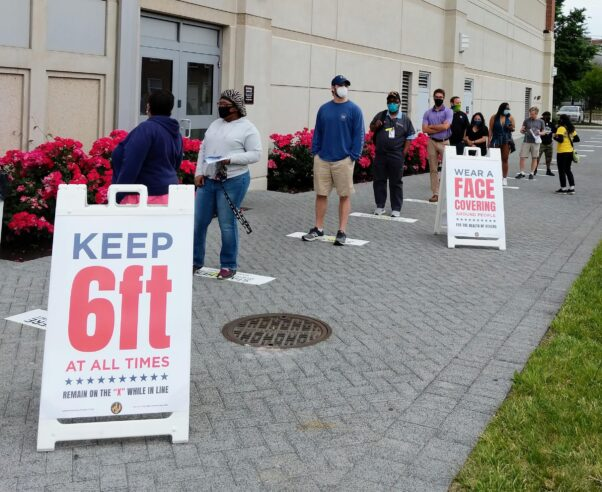 Voters wait in line to enter a voting center during Maryland's primary election on June 2, 2020. (Photo: Rachel Baye/WYPR)