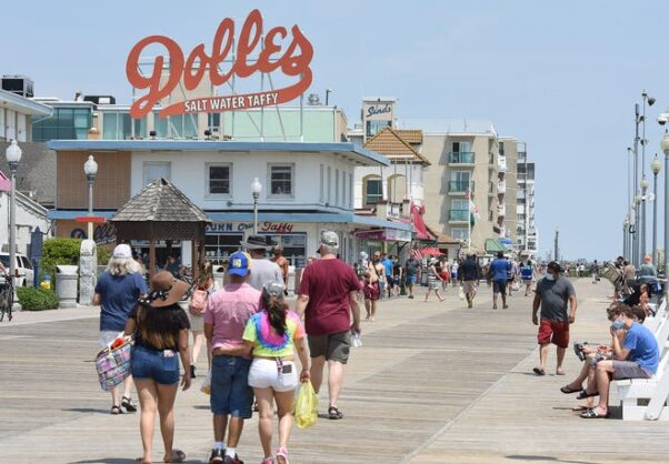 People walk along the Rehoboth Beach boardwalk on June 27, 2020 waring masks. (Photo: Chuck Snyder)