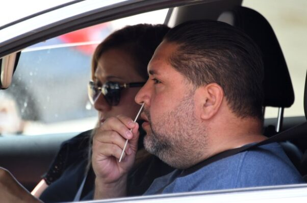 Jesse Bringas of Pico Rivera, Calif., takes a COVID-19 test as he swabs his nose on May 12, 2020. (Photo:  Keith Birmingham/Pasadena Star-News)