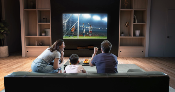 A famiy is watching soccer n TV and celebrating a goal. (Photo: Shutterstock)