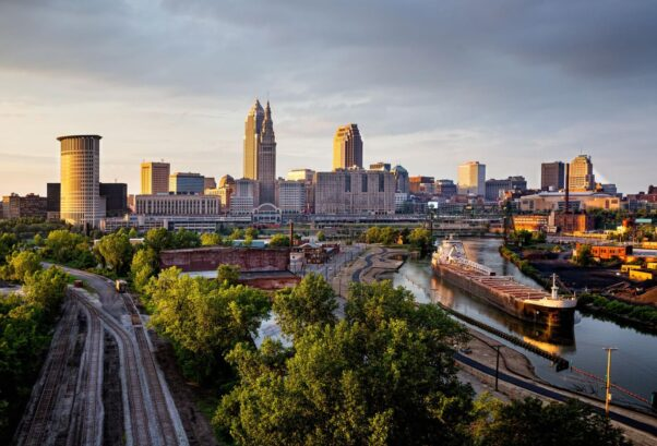 Photo of the Cleveland skyline with a barge on Lake Erie. (Photo: Ken Redding/Getty Images)