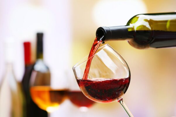 Red wine being poured into a glass. (Photo: Shutterstock)