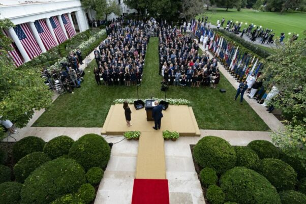 President Trump and Amy Coney Barrett stand on a stage in the Rose Garden on Sept. 26, 2020 in front of a crowde of seated people. (Photo: Alex Brandon/AP)