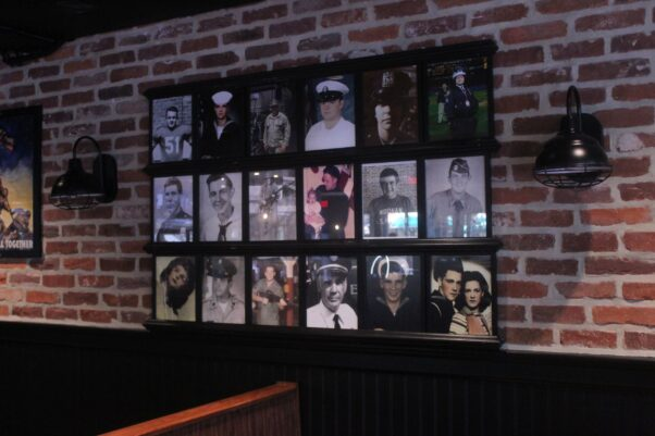 The restaurant's wall of heroes featuring veterans and first responders. (Photo: Mark Heckathorn/DC on Heels)