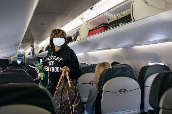 A woman boards a plane from Detroit to D.C. on June 9, 2020. (Photo: Alyssa Schukar/New York Times)
