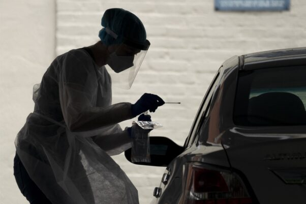 A medical worker administers a coronavirus test at a drive thru testing site at George Washington University on May 26, 2020. (Photo: Drew Angerer/Getty Images)