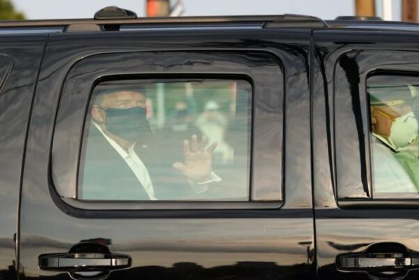 President Trump waves to supporters outside Walter Reed National Military Medical Center on Sunday on a brief leave from the hospital. (Photo: Alex Edelman/AFP via Getty Images)