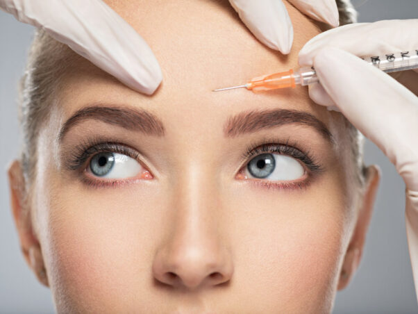 A woman getting a Botox injection in her left eyebrow. (Photo: Shutterstock)