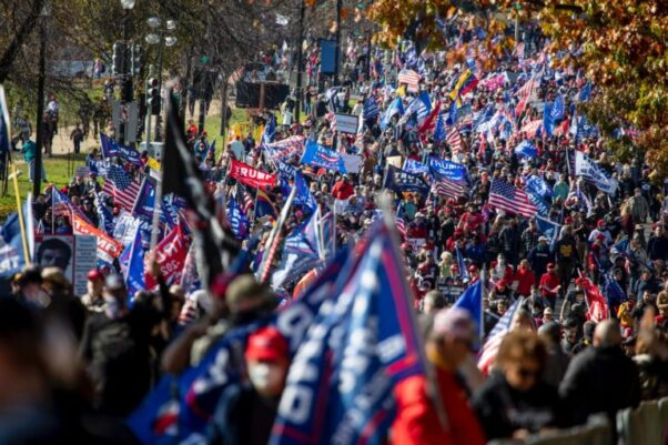 Thousands of demonstrators make their way down Constitution Avenue towards the Supreme Court after rallying in Freedom Plaza on Nov, 14. (Photo: Tyrone Turner/WAMU)