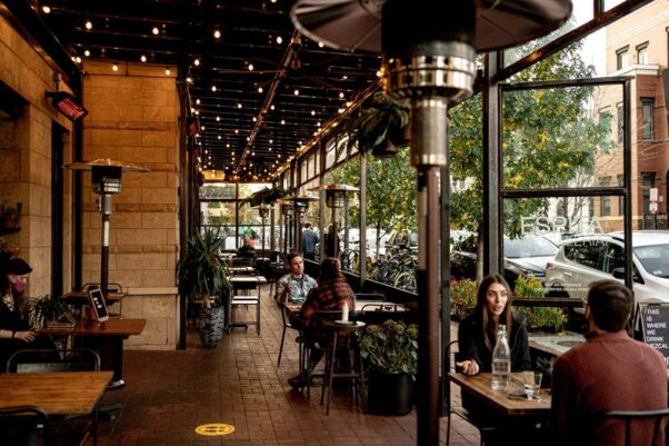 Diners eat on the outside patio at Espita Mezcaleria near the convention center with outdoor heaters. (Photo: Leah Judson)