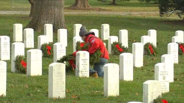 A man lays a wereat on a grave at Arlington National Cemetery on Dec. 19, 2020. (Photo: Screen Capture/Arlington National Cemetery)