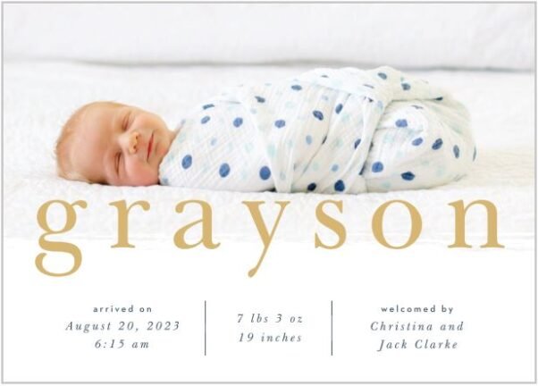 A sample birth announcement with a baby boy swaddled in a white blanket with dark blue polka dots that includes the baby's name, birthday, length, weight and parents' names. (Photo: Basic Invite)