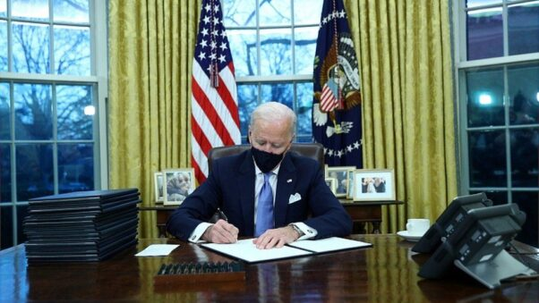 President Joe Biden signs one of 16 executive orders on Jan. 20, 2021, shortly after being sworn into office. (Photo: Reuters)