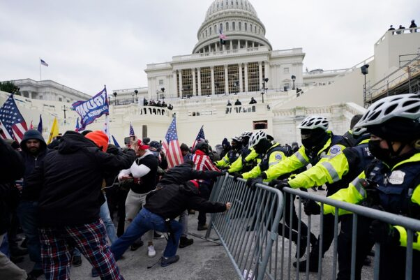 Trump supporters try to break through a police barrier, Wednesday, Jan. 6, 2021, at the Capitol in Washington. As Congress prepares to affirm President-elect Joe Biden's victory, thousands of people have gathered to show their support for President Donald Trump and his claims of election fraud.(Photo: Julio Cortez/AP)