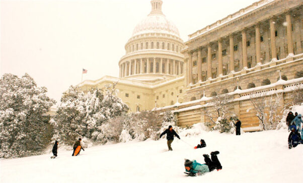 People sled down the hill on the west side of the U.S. Capitol. (Photo: Valerie Hinojosa/Flickr)