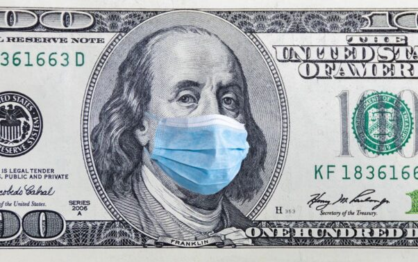 A $100 bill with Ben Franklin wearing a blue surgical maslk. (Photo: Getty Images)