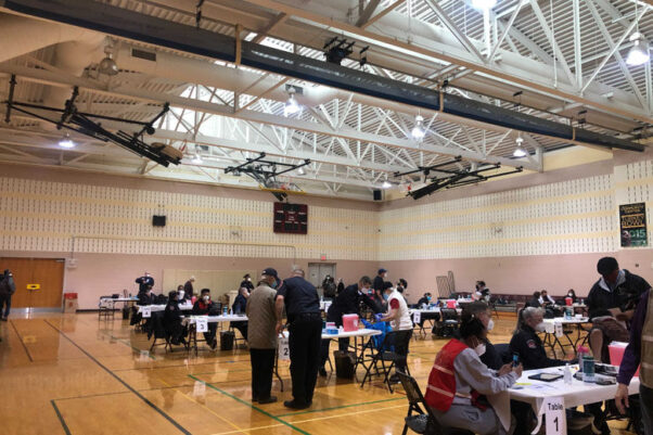 Vaccination stations set up in the gymnasium of the East County Community Recreation Center in Silver Spring on Sunday, Feb. 21, 2021. (Photo: Acacia James/WTOP)
