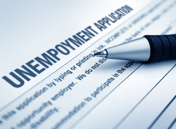 An unemployment application with a pen laying on top of it. (Photo: Getty Images)