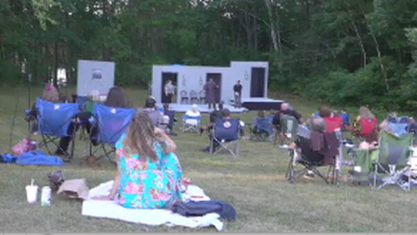 People watching an outdoor performance in Agusta, Maine. (Photo: WMTW)