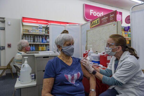 Geraldine Tetreaut receives her vaccination from pharmacist Doris Arundel at a CVS Pharmacy in Putnam, Conn. (Photo: Mark Mirko/Hartford Courant)