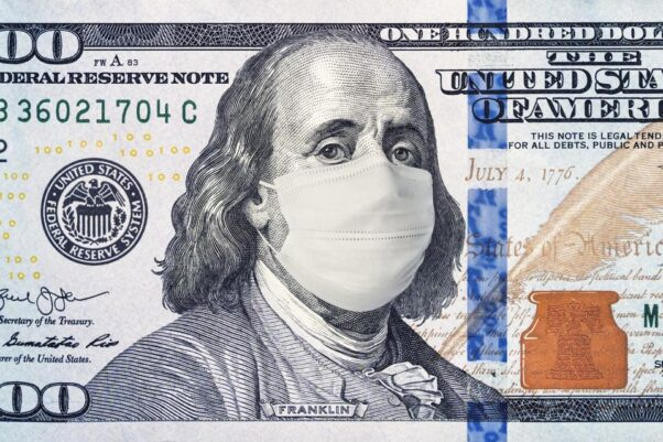 A $100 bill with Benjamin Franklin wearing an N-95 face mask. (Photo: Getty Images)