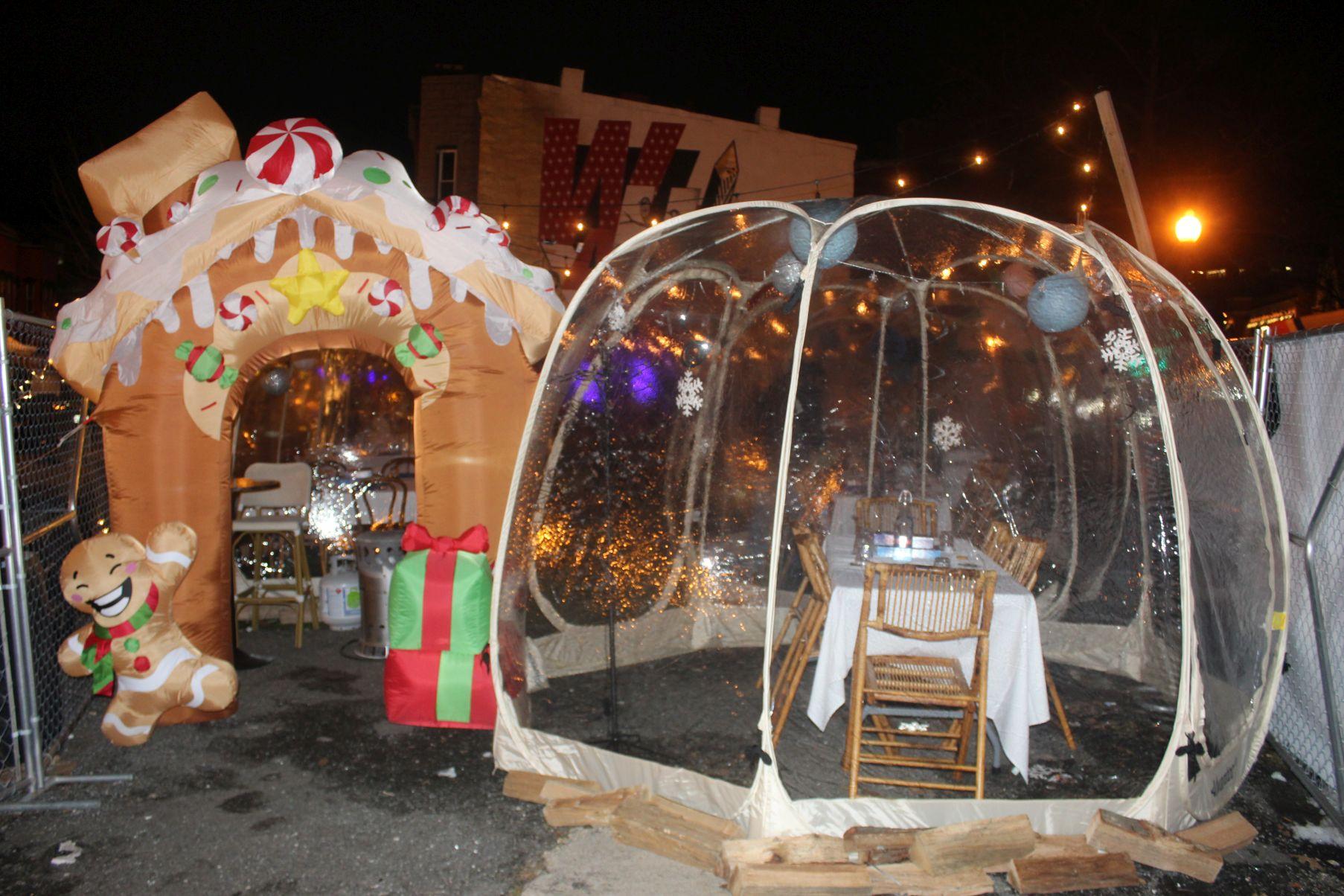 An inflatable gingerbread house beside an igloo at the enterance to HalfSmoke's Winter Wonderland pop-up. (Photo: Mark Heckathorn/DC on Heels)