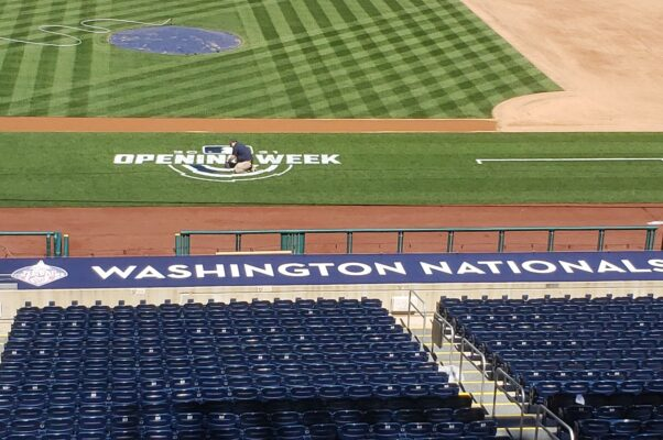 A worker paints the MLB Opening Week logo on the first base side of the field Tuesday, March 30. (Photo: Mark Heckathorn/DC on Heels)