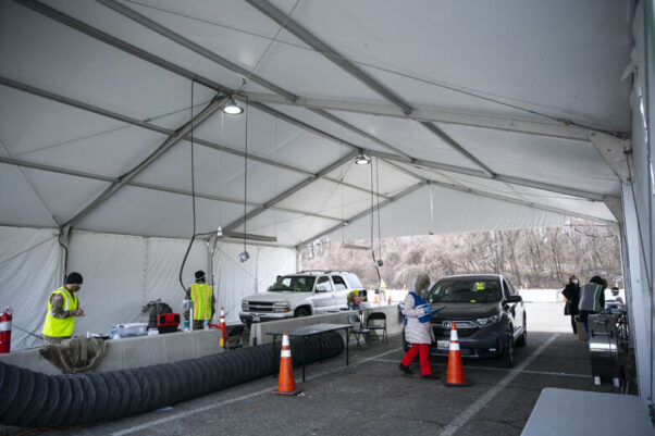 People wait in their cars inside of a mass vaccination tent in the parking lot of Six Flags on Feb. 6, 2021.  (Photo: Sarah Silbiger/Getty Images)
