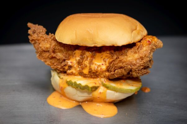 Fuku's spicy friend chicken sandwich with pickles and sauce (Photo: Clay Williams&gt)