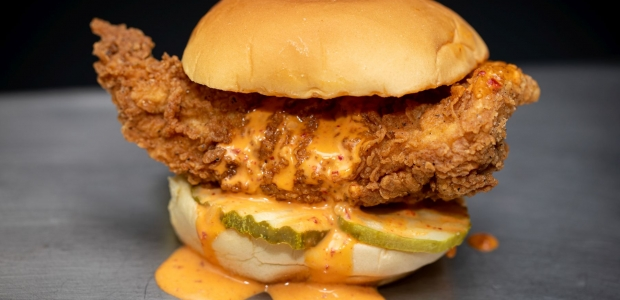 Fuku's spicy friend chicken sandwich with pickles and sauce (Photo: Clay Williams>