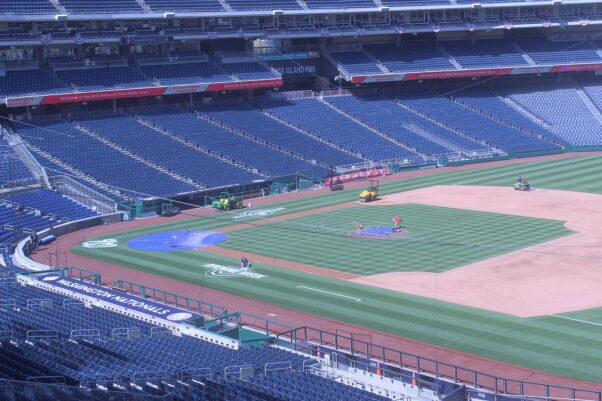 Grounds crew prepares the field for opening day on March 30, 2021. (Photo: Mark Heckathorn/DC on Heels)