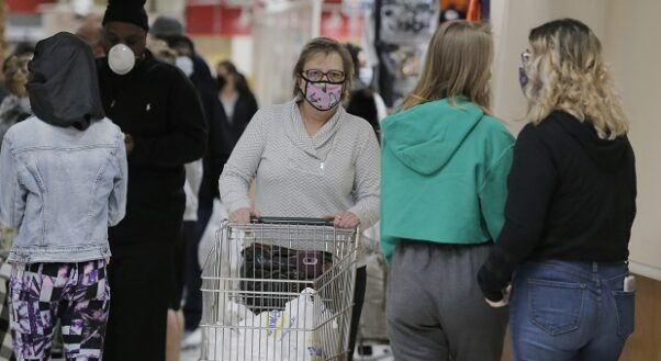 People wear masks to protect themselves and others from the coronavirus as they shop at the Pennsylvania Dutch Market in Cockeysville, Md. (Photo: Julio Cortez/AP)