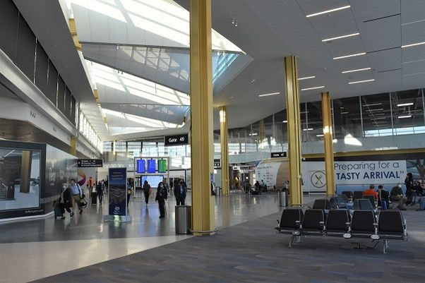 Travelers in the new concourse at Regan National Airport on opening day, April 20, 2021. (Photo: Reagan National Airport)
