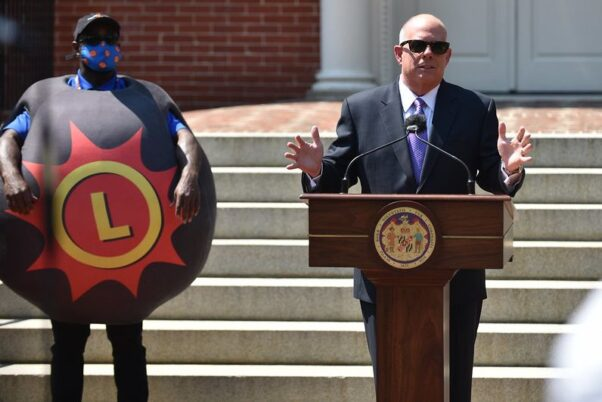 Maryland Gov. Larry Hogan and the Maryland Lottery's Lotto ball mascot at a press conference May 20,2021 on the steps of the Maryland Statehouse. (Photo: MdGovPics/Flickr)